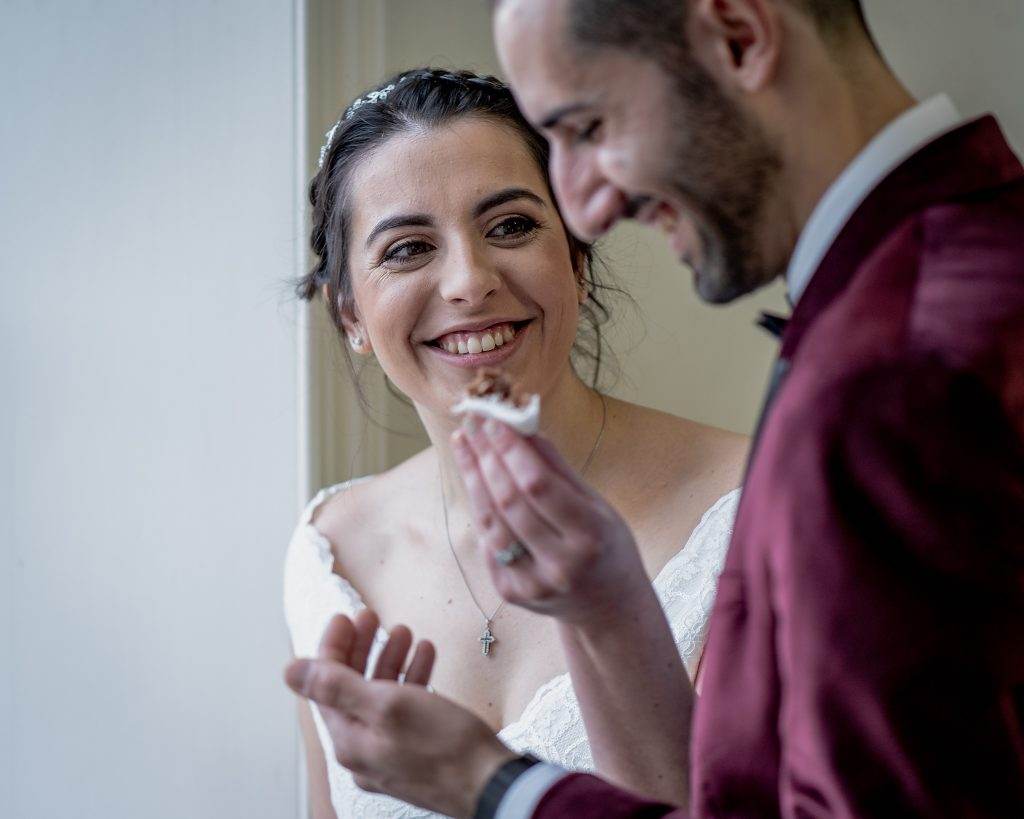Sharing cake after wedding ceremony