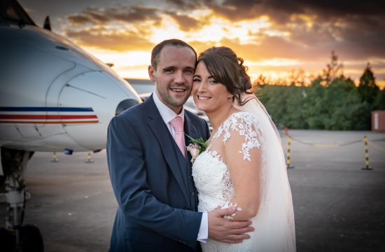 Bride and Groom in front of plane