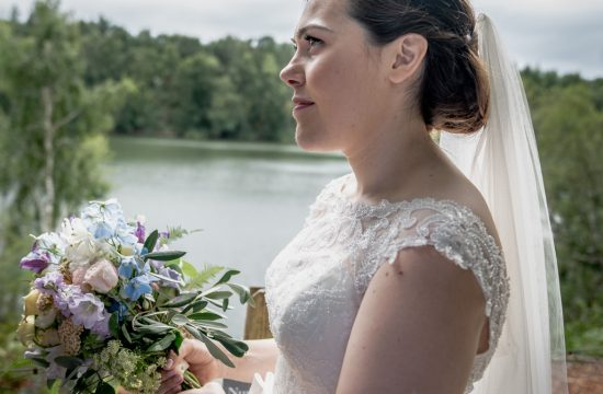 Bride portrait next to the lake at Nunsmere hall