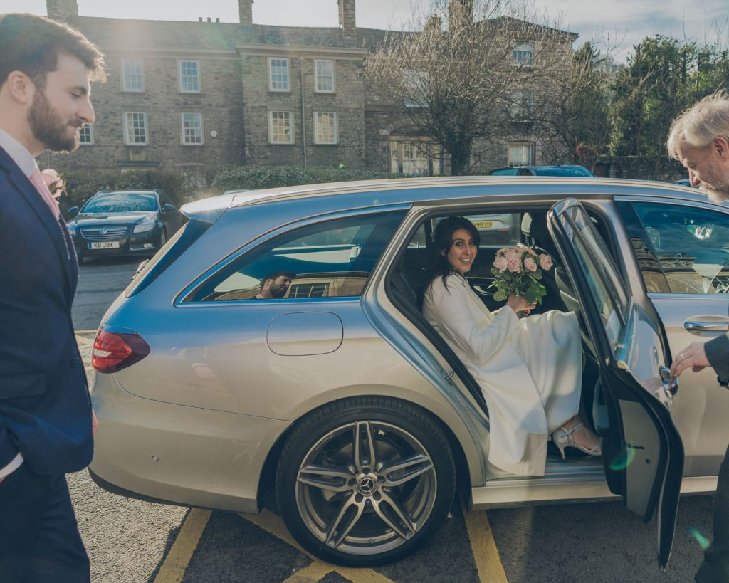 Bride in car after wedding ceremony