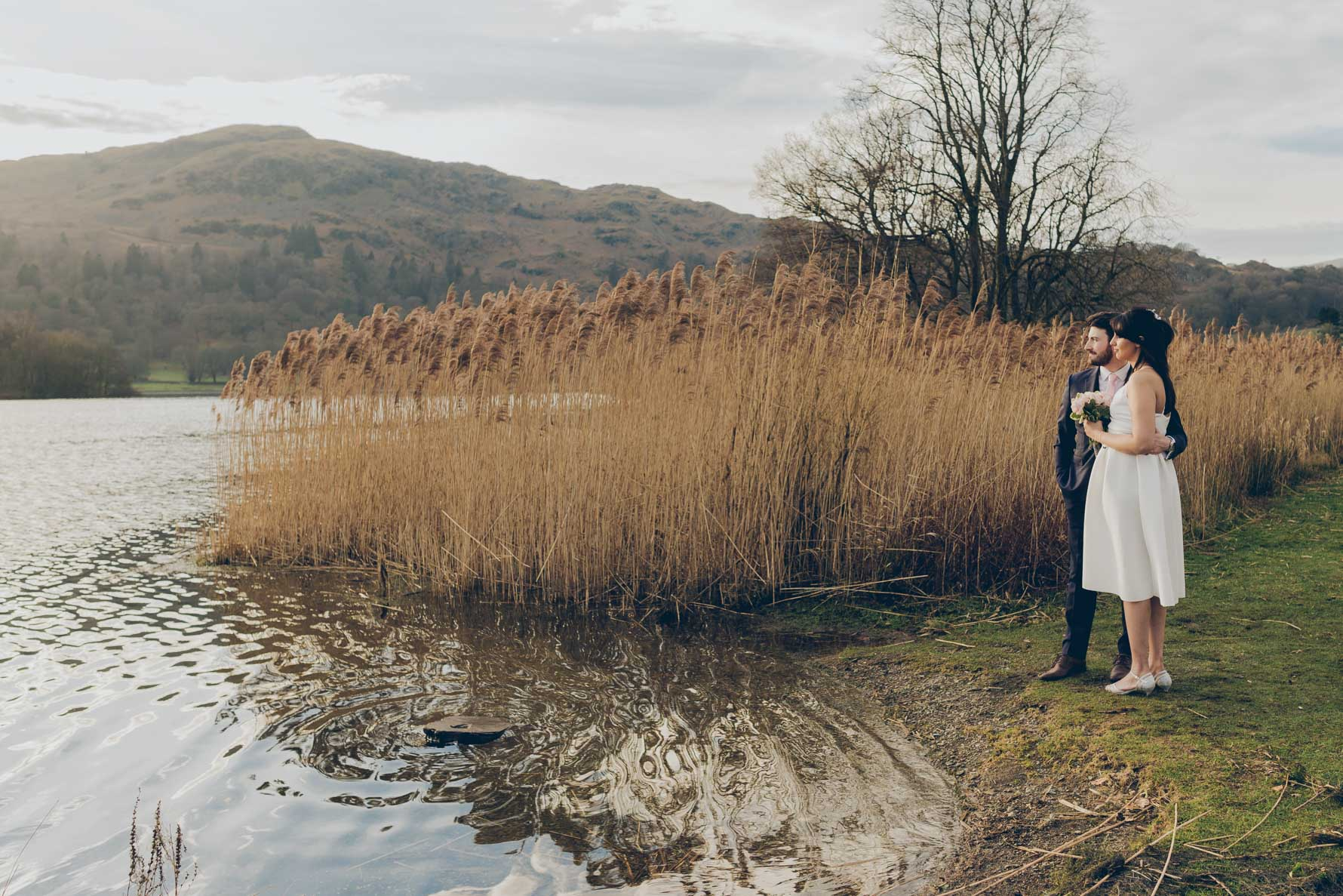 Bride and Groom looking out to the lake