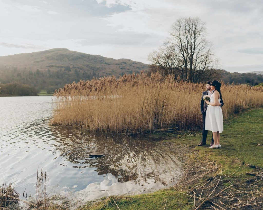 Bride and Groom portrait on the lakeside in the grounds of the Daffodil Hotel