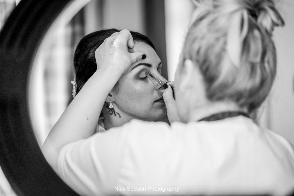 Bride preparations through ring light