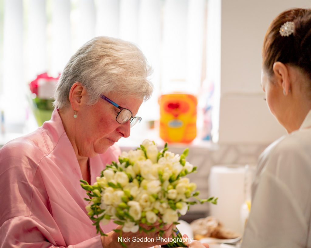 Brides mum checking the bouquet