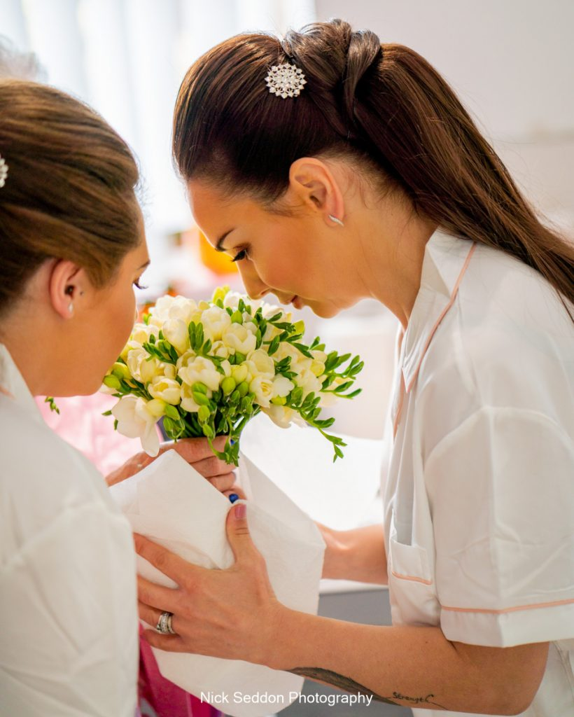 Bridesmaids smelling the bouquet