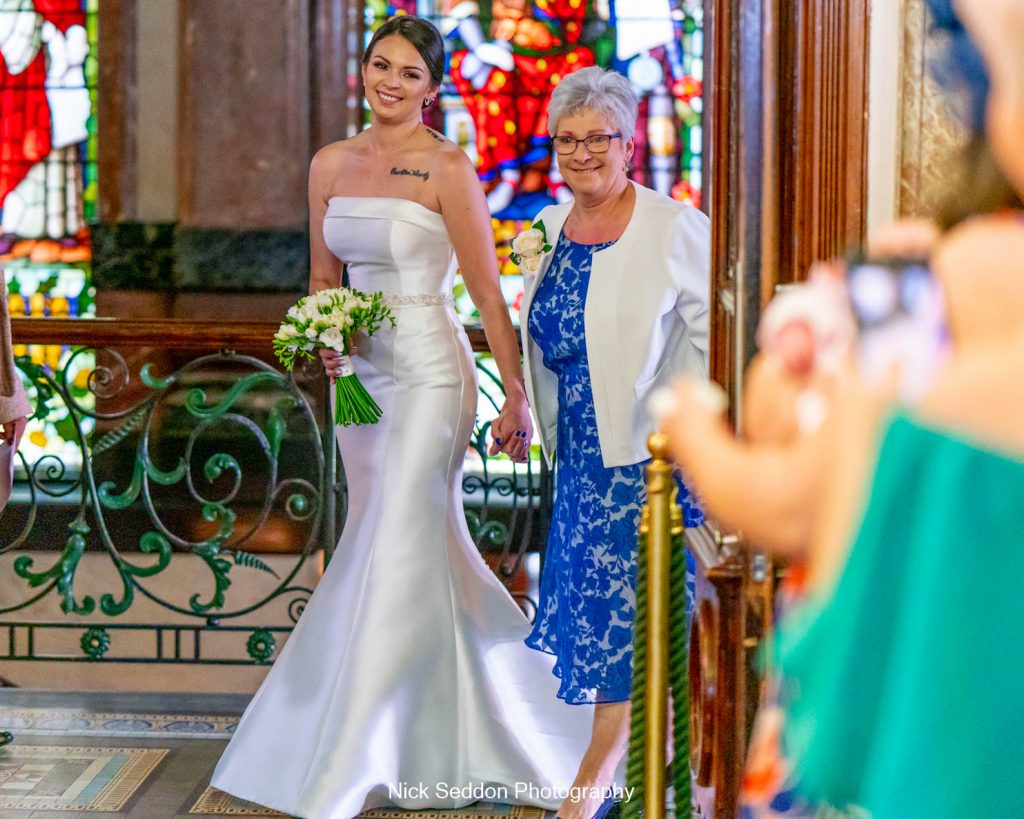 Bride and Mother walking down the isle